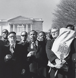 Rabbi Abraham Joshua Heschel, Rev. Martin Luther King, Jr., and Rabbi Maurice Eisendrath (carrying the Torah) in Montgomery