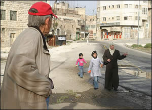CPT volunteer accompanying children as they go to school in Hebron; they're often harrassed by settlers.