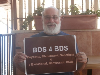Jeff Halper of Israeli Committee Against House Demolitions, with visual aid.